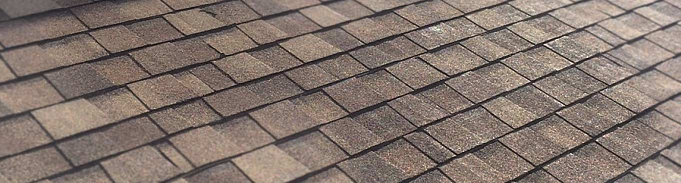 A close up of brown and tan shingles