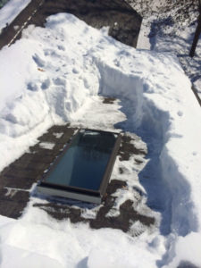Heavy snow accumulation cleared around skylight